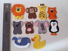 Get wood cutout animals and glue magnets on the back then let the kids play w/ them on the fridge