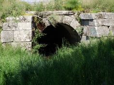 Old stone arch, sewer entrance.