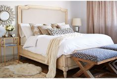 Neutral Bedroom. Love the upholstered bed with nail-head trim and oatmeal linen fabric on the headboard