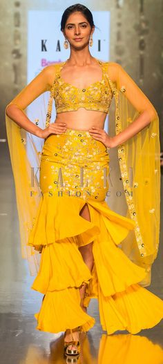 Buy Online from the link below. We ship worldwide (Free Shipping over US$100)  Click Anywhere to Tag Dustan-sun-mustard-frilled-layer-skirt-with-matching-crop-top-along-with-a-cape-style-jacket-only-on-Kalki Indian Dresses, Indian Outfits, Party Wear Dresses, Wedding Dresses, Layered Skirt, Desi, Mustard, Cape, Women's Fashion