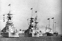 Royal yacht Victoria and Albert passing 15 in battleships HMS Ramilles, HMS Royal Sovereign and HMS Queen Elizabeth during King George V's silver jubilee review of the fleet at Spithead, 1935.