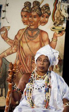 Djabassi Manonwomin, a voodoo priestess, right is seen in her shrine during the annual Voodoo Festival in Ouidah, Benin, Jan. 10, 2013. CREDIT: AP Photo/Sunday Alamba