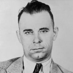 """John Herbert Dillinger was born June 22, 1903, in Indianapolis, Indiana. As a child he went by """"Johnnie."""" As an adult he was known as """"Jackrabbit"""" for his graceful moves and quick getaways from the police. As a legend, he was known as """"Public Enemy Number One."""" His exploits during the depth of the Great Depression made him a headline news celebrity and one of the most feared gangsters of the 20th century."""