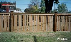 This rail picket fence includes caps on the fence posts and a custom gate. Description from midwestfence.com. I searched for this on bing.com/images