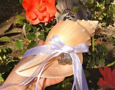 Beach Wedding Tuba Shell Ring Bearer Pillow Alternative w/ Custom Ribbons by JsWorldOfWonder, via Etsy.