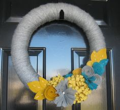 This design came from Papersnitch who is pinned on Pinterest.  Thanks to you!  The bride gave me her pic and all that was changed was number of flowers and proportions of flowers. The other wreath with the letter was my design, as well as the bouquet.