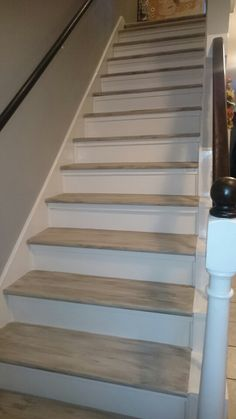 DIY-Updated stairs by removing carpet and painting the treads with home made chalk paint.