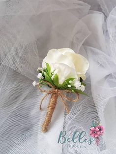 Check out this item in my Etsy shop https://www.etsy.com/uk/listing/574449638/stylish-simple-wedding-buttonhole-ivory