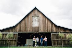 Groomsmen taking bets on the weather in the good ol PNW! Lazy River Farm in Kent, WA Barn wedding / Rustic / PNW / Distillery