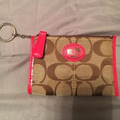Coach Khaki/Watermelon color mini skinny No stains or signs of wear inside and out. The keychain has signs of wear- not really scratches, looks like the overlay on the hardware. Tried to showcase in pictures. From a Smoke-free/pet-free home. No dust bag, sorry. This is not a Coach Factory/Outlet bag, the wristlet came from retail. Coach Bags Clutches & Wristlets