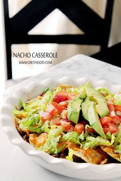 Nacho Casserole | www.diethood.com | Nacho Casserole made with layers of ground beef, tomatoes, tortilla chips and lots of cheese! | #recipe #casserole #nachos #avocado