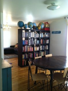 "Our ""library"", separating our dining room and living room"