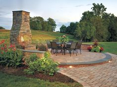A Fireplace for All Seasons You can enjoy dining al fresco year round with this striking fireplace patio made of Cast Veneer Stone. www.ephe...