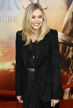 A gorgeous mid-length cut with long layers on Elizabeth Olsen.