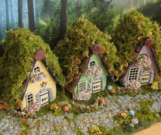 The Fairy Houses of Mossy Lane Handcrafted by bewilderandpine - adorable tiny fairy houses - could do with maybe just a bit less moss up top, but I love the look from the front and the tiny flowers by the windows