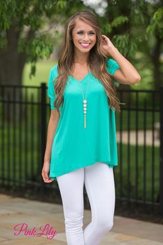 You're going to love wearing our adorable Piko tops all summer long! Featuring a v-neckline, short sleeves, and a lovely shade of teal, it's so perfect for pairing with jeans, jeggings, or shorts!