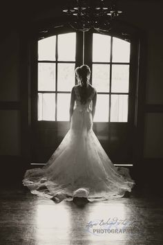 Bride in front of double doors. The light reflecting is beautiful.- Bride's Silhouette.