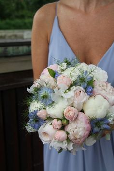The Bouquets in pale pastel hues, blush pink , pale 'Wedgewood' blue and ivory matched the Bridesmaid's dusky blue gowns perfectly