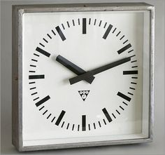 Square steel-cased factory wall clock, Pragotron