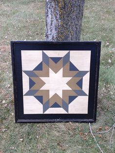This listing is for the 2 Small Frame version of Harvest Star (in Grays!) These hand-painted Barn Quilts are very rustic and will look awesome hanging outside on a house or garage or used as inside wall decor as well! Available in many patterns and colors, this particular pattern is Harvest Star and available in 2 x 2. Pictured colors are Warm White, Country Tan, Antique Tin, Charcoal and Black. All of my barn quilts are hand-painted on 1/2 plywood, with a 3/4 pine edge frame in black…