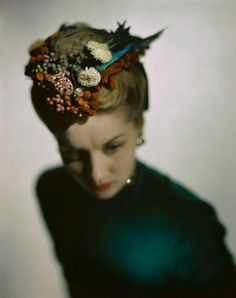 1946  photo by Constantin Joffe    Model is wearing a Lilly Daché 'bonnet-coif' of flowers, feathers, and fruit.