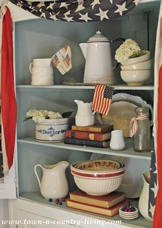 Create a patriotic decorating vignette using items from around the house in a red, white, and blue color scheme