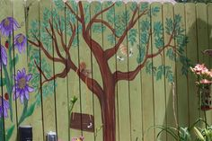 Karen Garrett of Cypress, TX is in the process of painting a mural on their Fence.  What an artist!
