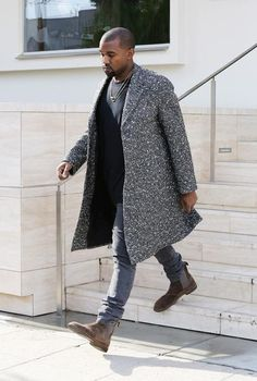 Dress in a grey herringbone overcoat and grey jeans for a seriously stylish look. Elevate this ensemble with brown suede chelsea boots.   Shop this look on Lookastic: https://lookastic.com/men/looks/grey-overcoat-black-crew-neck-t-shirt-grey-jeans/18014   — Black Crew-neck T-shirt  — Grey Herringbone Overcoat  — Grey Jeans  — Brown Suede Chelsea Boots