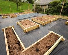 Building a Potager - Vegetable Garden. New raised wooden beds in the potager before gravel and plants are added. Photographer: Clive Nichols -  Design: Clare Matthews