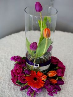 Centrepiece for a wedding or formal dinner. Orchids would look nice too.
