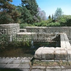 Pond - Storer House / 8161 Hollywood Blvd., Los Angeles, CA / 1923 / Mayan Revival / Frank Lloyd Wright -- The maze-like terraces incorporate organic materials with moss and hidden ponds.