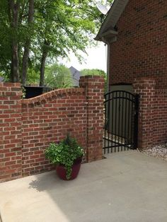 Photos Of Champion Fence Builders Charlotte Nc Decorative Brick Wall W Aluminum Arched Gate