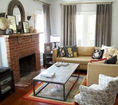 cozy living room...exposed brick fireplace...panel draperies