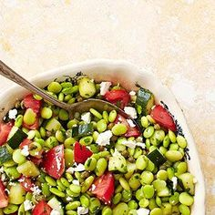 Filled with cucumbers, tomatoes, and a lemon-garlic dressing, this unique Middle Eastern Fresh Fava Bean Salad is bursting with fiber and protein. More healthy recipes: http://www.bhg.com/recipes/party/party-ideas/heart-healthy-potluck-recipes/#page=2 #myplate