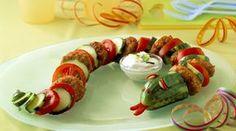 Schlange aus Frikadellen und Gemüse