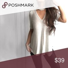 Choker Colder Shoulder Slinky Shirt Light heathered grey/white color..slinky material...slight trapeze shape with short sleeves. Features a trendy choker. Casual trendy top that has a dimensional edge to simplicity. 95% rayon 5% spandex....I am modeling size small. Boutique Tops Tees - Short Sleeve
