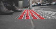 Australian firm Büro North has devised a concept for in-ground traffic lights to prevent pedestrians walking out onto the road.