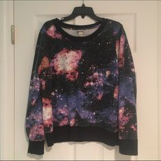 Mossimo Supply Co Galaxy Sweatshirt Like new condition, only worn a few times.  I am usually an M and this fits me as an oversized sweatshirt but is not overly baggy. Mossimo Supply Co. Sweaters Crew & Scoop Necks