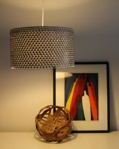 Soda can pop tab lamp shade! perfect for me since I take all my tabs off before drinking out of a can
