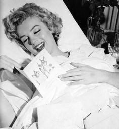 Marilyn reading a card from Joe after her recovering from having her appendix removed in May 1952.
