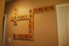 Extra Large Scrabble Pieces that Spell Our Family Names -- Love this idea! I'd like to put our last name in the middle and then build all of our names off of that.