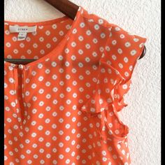 Silk J.crew top This beautiful orange 100% silk top is ready for spring.  It has a keyhole neckline with small button and flutter sleeve.  Size four, in excellent condition. No trades. Price firm. J. Crew Tops Blouses