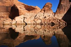 We were the first boat into Davis Gulch this morning and because of that, this is what we found… eerily still waters mirroring the sculptured rocks and dark blue skies. The rock face took on gigantic organic shapes, a few suggesting arrows pointing into the canyon. Absolutely breathtaking.