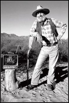 Edward Abbey with a TV he shot a hole in!