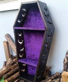 Coffin & bats display shelves by Life After Death Design