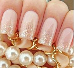 Love these nails. Nude pink with gold glitter tips