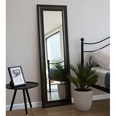 A classic mirror in a black wooden frame that can liven up and visually expand your living space. Traditionally shaped, it adds a chic touch to a bedr Full Length Mirror With Shelf, Full Length Mirror Design, Unique Mirrors, Cool Mirrors, Beautiful Mirrors, Spiegel Design, Home Design Decor, Home Decor
