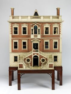 """Renowned for its world-class collection and dedication to preservation, London's Victoria and Albert Museum of Childhoodoffers a nostalgic look at Great Britain's cultural heritage. Recently, the institution loaned a dozen of its prized dollhouses to the National Building Museumin Washington DC for a special show titledSmall Stories: At Home in a Dollhouse. The exquisite exhibition features twelve dollhouses, offering a range of """"country mansions, the Georgian town house, suburban…"""