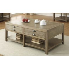Add a gorgeous classic look to your living room or den with the Cottage coffee table. The soft driftwood finish and simple design ensures that this coffee table will blend well with a variety of different decors.