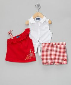 Fit for a picnic or playing in the flower bed, this fun ensemble boasts darling appliqués and ruffled accents. The button-up blouse includes a tie at the bottom and nestles in nicely under the charming top and faux-button shorts.